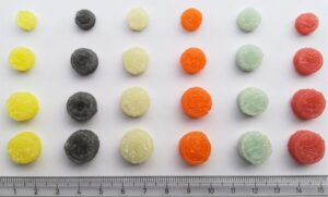 Figure 2. Chewable printlets (3D printed tablets) in different flavours, colour and doses.